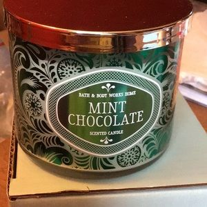 Bath and Body Works candle.        E